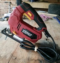 red and black Black & Decker corded power tool Houston, 77044