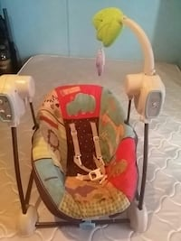 baby's red, gray, and red swing chair