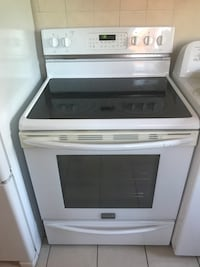 white and black induction range oven Laval, H7M 2E8