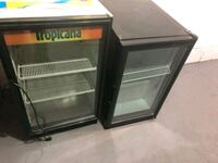 two black wooden framed glass display cabinets 210 mi