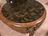 Round brown carved wooden coffee table Alexandria, 22304