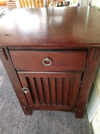 Bedside table with cabinet and drawer.