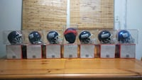 NY Giants Authentic Mini Helmets in display cases. Ashburn, 20147
