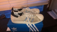 pair of gray Adidas Superstar shoes Glen Carbon, 62034