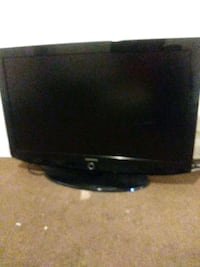 black flat screen TV with remote Greenbelt, 20770