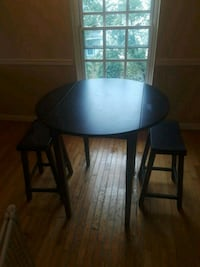 round black wooden table with two chairs Occoquan, 22125