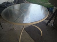round  metal framed glass-top patio table Vancouver, 98662