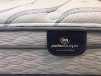 white and gray Serta PerfectSleeper mattress