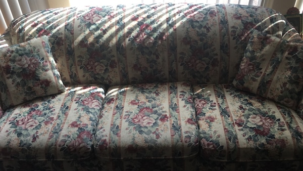 gray, green, and red floral three seat sofa