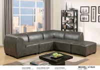 Grey leather sectional. 33014