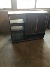 Old School real wood entertainment cabinet with shelves and glass door for equipment you are responsible for moving but I can help load. Battle Creek, 49015
