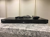black Sony DVD player with remote