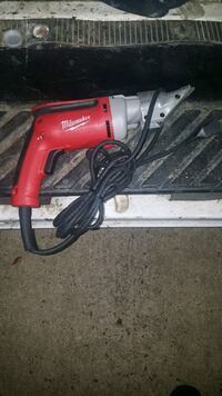 red and gray Milwaukee corded power tool Houston, 77099