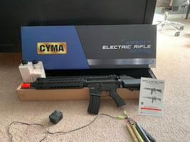Airsoft gun, charger, 2 batteries, approx 4000 bb's, with original box