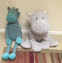 Two gray and blue animal plush toys