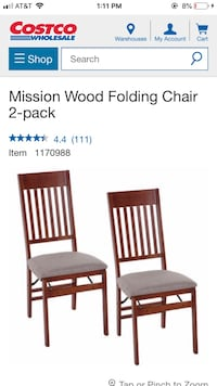 two brown wooden framed black padded chairs 347 mi
