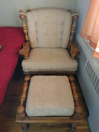 brown wooden framed beige padded glider chair 784 km