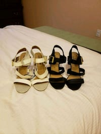 pair of black and a pair of white leather sandals Surrey, V3R 4C7