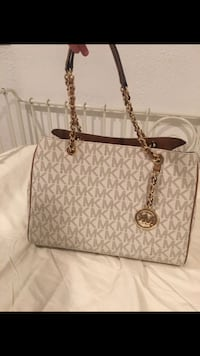 gray and beige monogram Michael Kors leather tote bag
