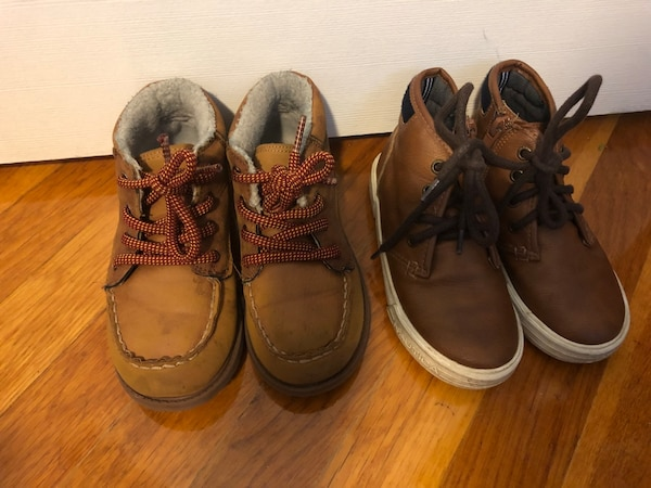 Two pairs of brown and black shoes