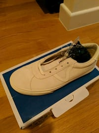 pair of white low-top sneakers New York, 10019
