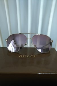 silver-colored framed aviator style sunglasses