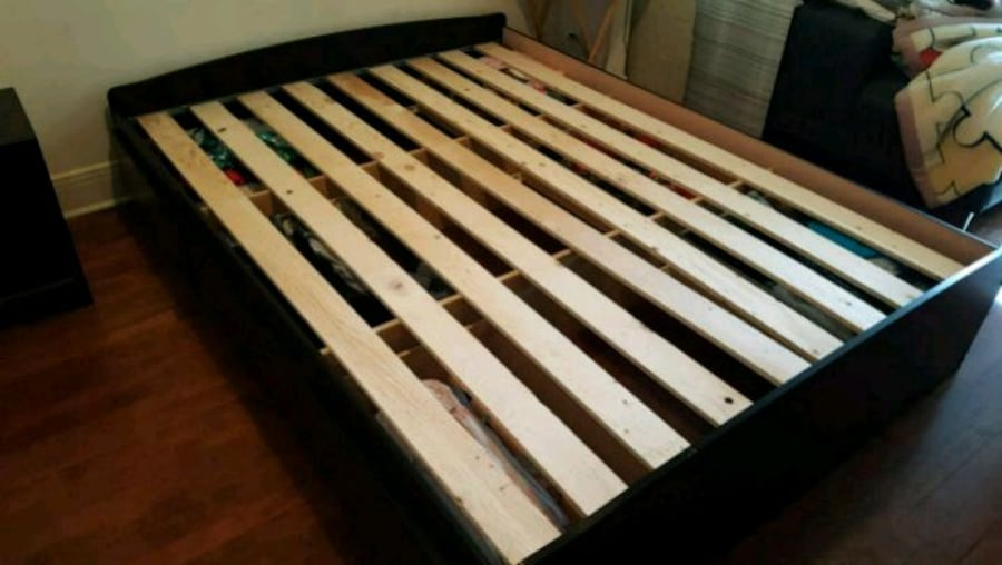 brown and white wooden bed frame a3999a74-e77b-4b31-ad2e-98093bcd465b