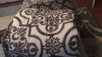 Double comforter set with bed skirt and two pillow shams.... black and white in good condition.... please contact me through letgo like sell as soon as possible Lusby, 20657