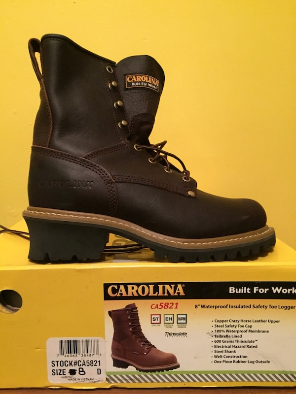 A pair of new boots  black with box