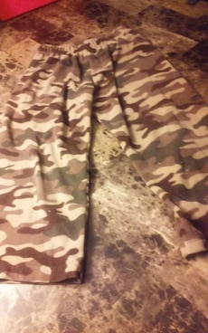 brown and white camouflage capri fabric pants