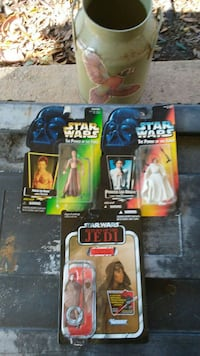 three Star Wars character action figures