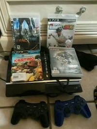 black Sony PS3 slim console with controller and game cases Sunland Park, 88063