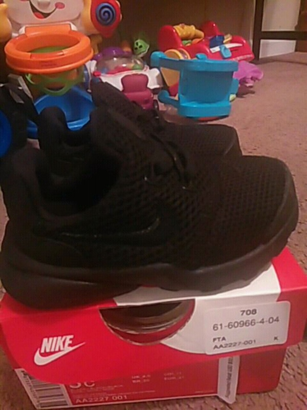 237d470a69fe Used pair of black Nike running shoesfor a baby size 5c for sale in ...