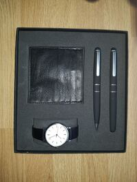 round silver analog watch with black leather strap in box Marsh Lane, S21 5RG