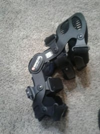 black and gray BREGs  womans knee brace Kansas City