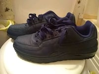pair of black Nike running shoes Bowling Green, 42101