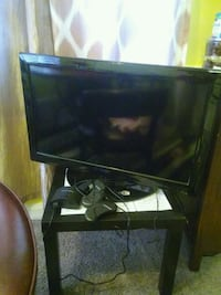 black flat screen TV with remote Dundalk, 21222