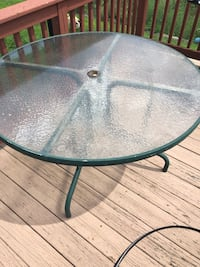 round black metal framed glass top patio table Johnston, 02919