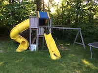 Yellow and brown wooden slide and wing outdoor playset Kentwood, 49546