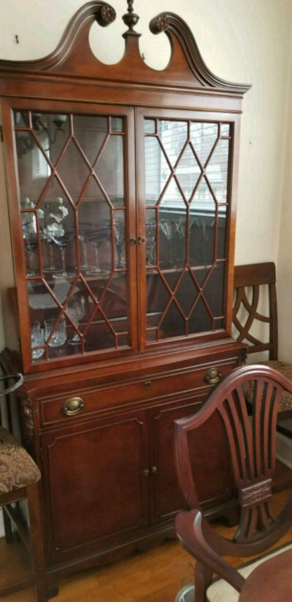 brown wooden framed glass display cabinet 0