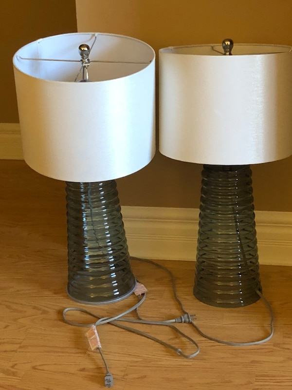 two white-and-black table lamps