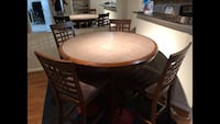 Hardwood round tile topped table with four hard wood chairs dinning set Houston, 77054