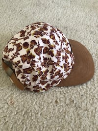 white and brown floral print cap Dover, 19901