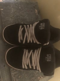 pair of black-and-white Adidas sneakers Surrey