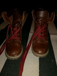 pair of red leather high-top sneakers Ottawa, K2J 3A9