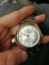 round gold-colored analog watch with link bracelet Moncton