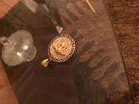Gold plated versace pendant
