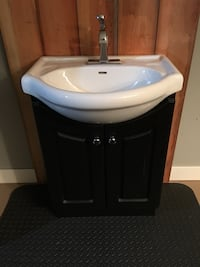 White ceramic sink with faucet and cabinet Kelowna, V1Z 1R4