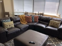 black leather sectional sofa with throw pillows Washington, 20036