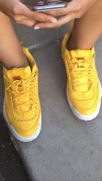pair of yellow-and-white Nike basketball shoes Phoenix, 85051